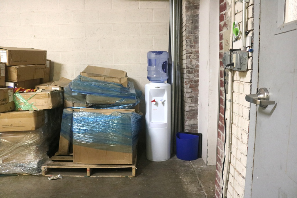 Water Cooler Next to Boxes
